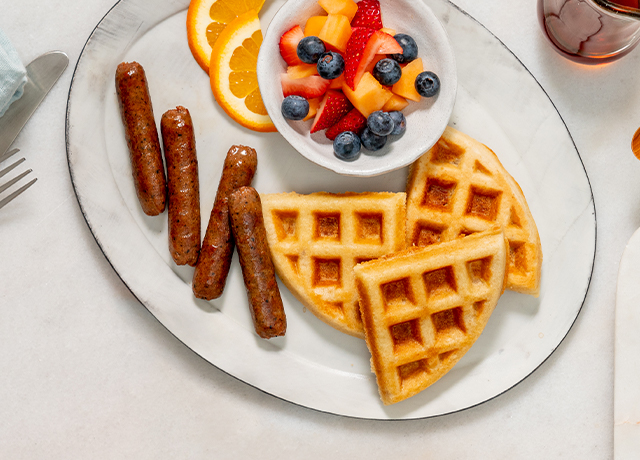 Plant-Based Breakfast Links and Waffles with Honey Melon Salad